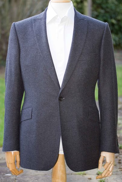 Tailored suit with peak lapel.